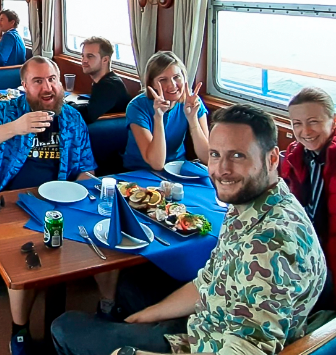 Having lunch on a boat on our way to Flakfortet