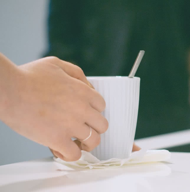 Hand holding a cup of tea